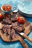 Grilled rib-eye steaks with tomatoes and lentils
