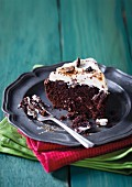 Cappuccino brownie cake with cream and coffee beans