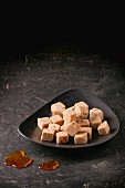 Caramel sweets on a brown plate