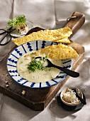 Horseradish foam soup with sauerkraut sponge