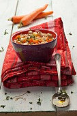 Rustic bean soup with carrot and chickpeas