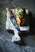 Grilled ox chop on a chopping board with a knife