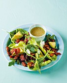 Green salad with avocado, bacon and almonds