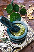 Nasturtium pesto in a mortar with ingredients