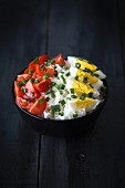 Rice salad with tomatoes, hard-boiled eggs and chives