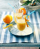 Oranges cocktails with pineapple and rum