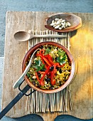 Vegetable paella with peppers and olives