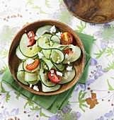 Spiral-cut cucumber with tomatoes and Gorgonzola cheese