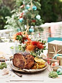 Roast ham on a garden table for Christmas