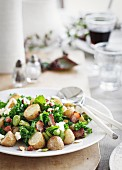 Potato salad with kale, beans and bacon