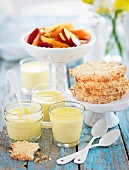 Lemon posset with biscuits and fruit salad
