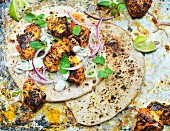 Grilled chicken on naan bread