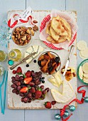 A cheese platter with fruit, nuts, compote and unleavened bread (Christmas)
