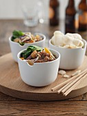 Sweet-and-sour beef with prawn crackers