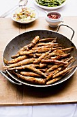 Fried smelts with a potato salad and beans