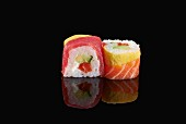 Two California maki with salmon and tuna fish