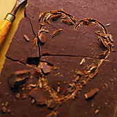 A heart carved in a slab of chocolate (close-up)