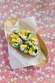 Vietnamese spring rolls filled with mango and crab