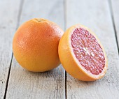 Pink grapefruit, whole and half
