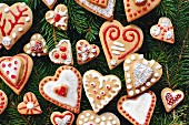 Heart-shaped gingerbread biscuits decorated with icing and sugar beads