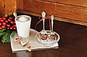 Luxury drinking chocolate on spoons, coffee beaker and festive biscuits