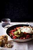 Baked tomato relish with a fried egg