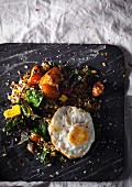 Fried rice with pumpkin, spinach and a fried egg