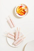 Peach ice lollies served with nectarine wedges