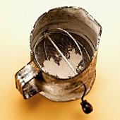 An old flour sifter