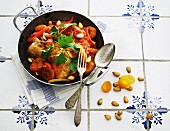 Chicken with apricots, almonds and peppers
