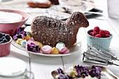 A baked Easter lamb with meringue dots on a serving platter