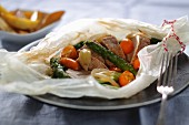 Pork fillet with vegetables and kumquats in paper