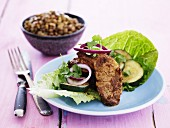 Pork escalope with courgette and red onions