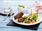 Kofta with vegetable salad and chips
