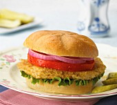 Chicken burger with gherkins