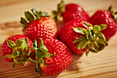 Organic strawberries on a wooden surface