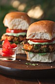 Two Indian veggie burgers on a wooden board