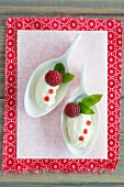 White chocolate mousse dumplings with raspberries and mint