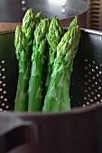Green asparagus in a colander