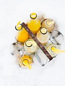 Bottles of lemonade in a bottle carrier in the snow (seen from above)