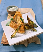 Perch fillet in an egg coating with fried courgette and herb mayonnaise