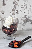 Fruit salad with blackberries, plums, grapes and cream