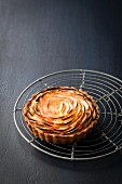 Apple tartlet on a wire rack