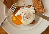 Toast with peanut butter and a poached egg on toast