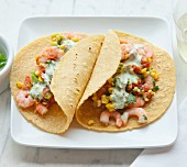 Tacos with prawns, sweetcorn and coriander