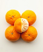 Five mandarins, one half peeled