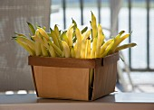 Yellow string beans in a wooden basket