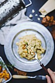 Risotto with mushrooms, goat's cheese and rosemary (seen from above)
