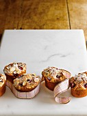 Friands with raspberries, lemons and flaked almonds as a gift