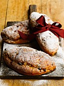Three stollen cakes with icing sugar as a gift